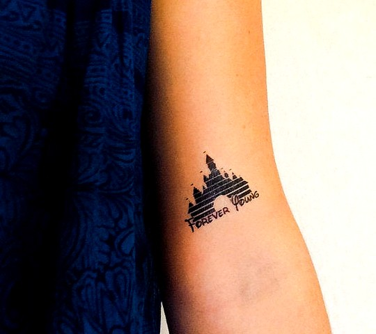 tatouage disney chateau bras forever young
